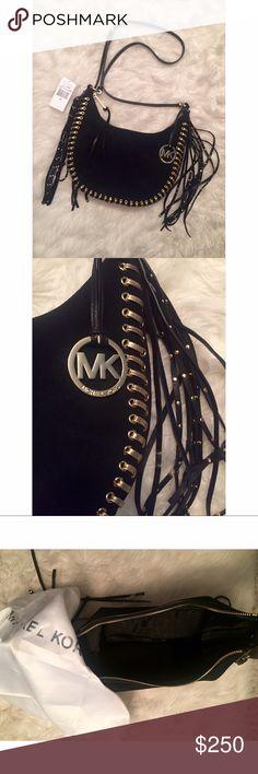"Michael Kors 'Rhea' Grommet Bag Michael Kors 'Rhea' Grommet Bag. Black suede with gold detailing. 23.5-25.5"" Adjustable strap. One zip pocket, two open pockets, 11.25"" x 6.25"" x 2.5"". Very boho-glam. Dust bag included. Retail: $350. Michael Kors Bags Mini Bags"