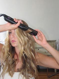 how to use a flat iron to curl hair with beachy waves.