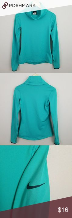 """Nike Dri-Fit teal cowl neck fitness sweater Sz S Excellent preowned condition. Teal with navy blue accents. Thumb hole sleeves. Microfleece inner lining.   Approximate measurements (garment laying flat): -Length 24"""" -Bust 15""""   55 Nike Sweaters Cowl & Turtlenecks"""