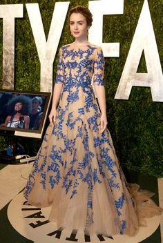 Don't have the slightest clue who Lily Collins is, but love the weirdness of this dress.