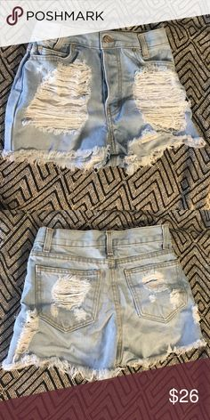 Ripped High Waisted Shorts Never worn high waisted shorts. Length is 12 inches Brandy Melville Shorts Jean Shorts