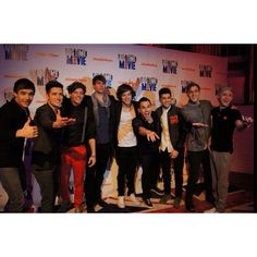 1D and BTR!!!(:  there were 2 BTR references in This Is Us...1 the picture with this background...2 one of the old concert clips from a long time ago with the really short stage that was when they opened for BTR :)