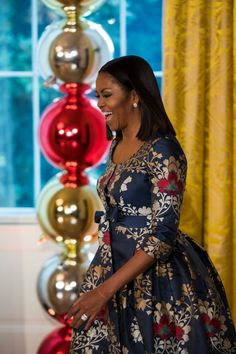 epa05652512 As part of the Joining Forces initiative, US First Lady Michelle Obama prepares to speak to military families invited to the White House to view the 2016 holiday decorations in Washington, DC, USA, 29 November 2016. The majority of the holiday decor was designed by Rafanelli Events and executed by 92 volunteers from across the country. EPA/JIM LO SCALZO