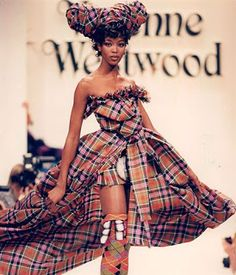 This dress was designed in the 1980's, when Westwood was in her phase she calls the 'Early Years', where remnants of punk fashion could still be found in her work, before she moved on to experiment with other styles.  I personally find this dress extremely beautiful, almost warrior-like. Though it is not made clear which fabric it is made out of, the pattern is in the burberry style. Fabric unknown.