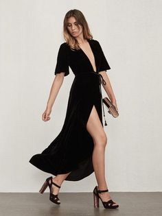 8294a27033e83 The Bordeaux Dress is a silk velvet wrap maxi dress with a plunging  neckline, gathered detailing at the shoulders and split short sleeves.
