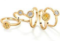 Yellow sapphire and diamond stacking rings by Robinson Pelham