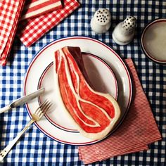 ❤️ceramic meat by @nathalie_lete with a @astierdevillatte plates and salt and pepper shakers on antique german ginghams Happy 4th!