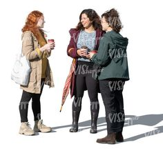 three cut out women standing and talking in autumn