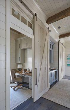 home office with sliding barn door