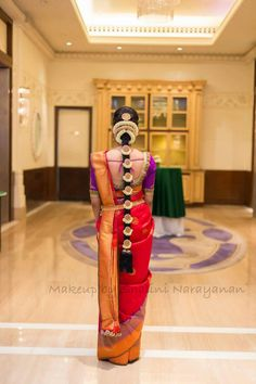 South Indian bride. Temple jewelry. Jhumkis.Red silk kanchipuram sari with contrast blouse.Braid with fresh flowers. Tamil bride. Telugu bride. Kannada bride. Hindu bride. Malayalee bride.South Indian wedding.