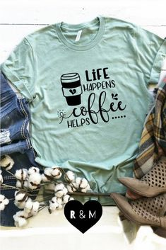 Life Happens Coffee Helps Life happens and coffee helps. The perfect shirt for any coffee lover. Perfect for you or to give as a gift for that coffee lover in your life. The post Life Happens Coffee Helps appeared first on Design Ideas. Funny Shirts Women, Funny Shirt Sayings, T Shirts With Sayings, T Shirts For Women, Funny Cat Shirts, Quote Tshirts, T Shirt Custom, Custom T Shirt Printing, Printed Shirts