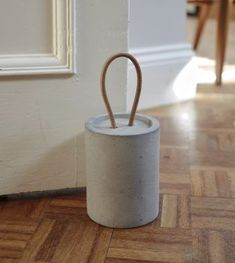 Concrete door stop with leather cord handle. Made from cast concrete using granite aggregates from a quarry in Leicestershire and treated with bees wax. Concrete Crafts, Concrete Wood, Concrete Projects, Concrete Design, Diy Doorstop, Smooth Concrete, Concrete Sculpture, Diy Shops, Door Stopper