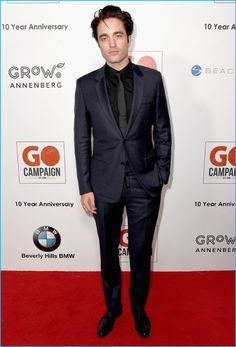 November 2016: Robert Pattinson wears a black and navy suiting look from Dior Homme to attend the 10th annual GO Campaign Gala.