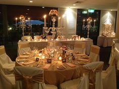 Our vintage wedding reception decorations / styling in pink, gold and champagne. Loads of vintage crystal and flowers.