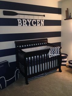Love the stripes and navy color for Jack's room. Interesting idea for the oar to hold his letters