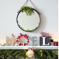 Christmas living room mantelpiece | festive decorating ideas | Ideal Home | Housetohome.co.uk