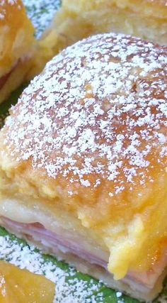 Monte Cristo Sliders - Ham, turkey & cheese sliders are topped with an egg-butter-mustard mixture, then baked & topped with sugar. Some serve with maple syrup.