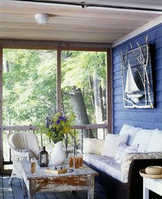 #Nautical wall decor on porch with wood panel, boat and sticks. #walldecor #porches  Browse DIY wall art on Completely Coastal: http://www.completely-coastal.com/search/label/DIY%20Wall%20Art