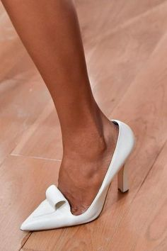 The 50 Best Shoes at NY Fashion Week | StyleCaster ZAC POSEN: Retro, and too chic for words, these white pumps on the runway at Zac Posen would work just well at the office, as they would at an evening event.   Read more: http://stylecaster.com/the-50-best-shoes-new-york-fashion-week-spring-2015/#ixzz3DAciD9Q2