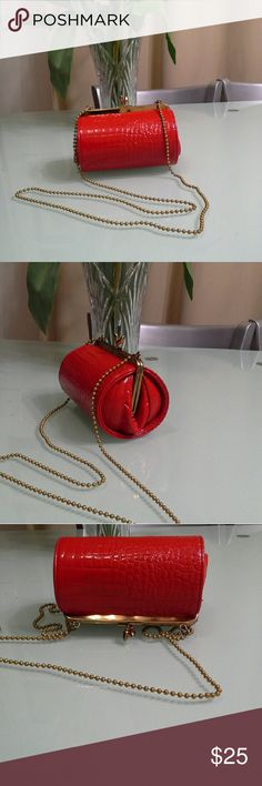 Red clutch Drum like clutch with golden beads like shoulder strap. SHIRLEY MILLER LTD. Bags Clutches & Wristlets