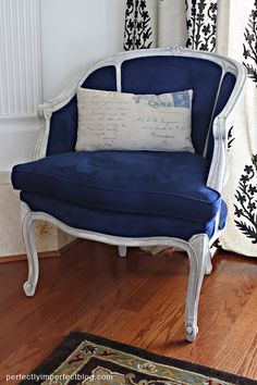 French upholstered royal blue chair with distressed chalk paint edges and letter pillow