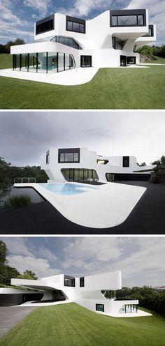 Haus außen Farben 11 modernen weißen Häuser aus der ganzen Welt / / die geschwungenen Linien und Pop schwarz gegen diesen großen weißen Haus verleihen ihm einen sauberen, futuristischen Look.