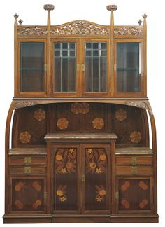 Gaspar Homar i Mesquida (1870-1953) - Sideboard. Carved Olive & Walnut with Hardwood & Fruitwood Marquetry Inlays, Marble Top & Shelves, Beveled Glass and Brass Hardware. Barcelona, Spain. Circa 1905. 295cm x 207cm x 53cm.