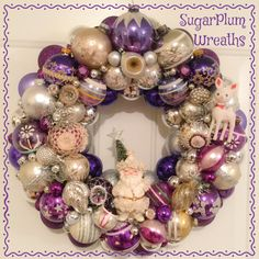 Custom order done! This large vintage ornament wreath is done in shades of purple and silver. I also used a cute vintage Napco Santa.  #sugarplumwreaths #vintagechristmas #vintagechic #vintageornamentwreath #retrochristmas #romanticchristmas