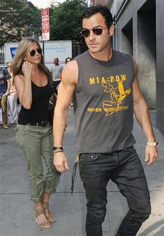 Jennifer Aniston and Justin Theroux venture out in New York on July 20, 2013. Love her cargo pants and tank top.