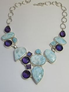 """Stunning statement piece in deep purple Amethyst and Caribbean Larimar gemstones, set in 925-hallmarked sterling silver. Length: 16-22""""+ Adjustable toggle clasp. Largest center dimension 2.5"""""""
