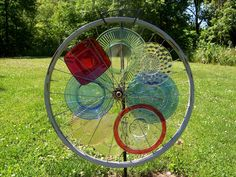 Glass plates inserted in an old bicycle wheel. Adds color to your yard!