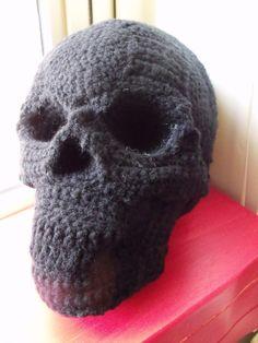 Lovely, detailed, crocheted skull pillow.