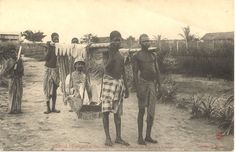 Translated caption reads: ''French Congo and Territories - Tipoye transportation in Loango''. A leader carried in a palanquin by four young men. Congo Français. Photograph by J. Audema. ca.1905