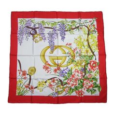 GUCCI Iconic Double GG Floral Silk Scarf Burst of Flowers Never worn   From a collection of rare vintage scarves at https://www.1stdibs.com/fashion/accessories/scarves/