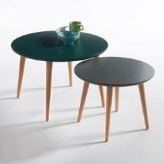 Les 2 tables basses gigognes Jimi. Un design épuré et minimaliste bien dans la tendance, les tables basses gigognes Jimi adorent recevoir : séparées, regroupées, elles se prêtent à toutes les combinaisons dans de superbes camaïeux de couleurs.Description des tables basse gigognes Jimi :Forme ronde.Semi-gigogne.Caractéristiques des tables basse gigognes Jimi :Plateau en MDF laqué blanc, finition vernis polyuréthanne.Pieds forme légèrement évasée style 50', bouleau massif, finition vernis n...