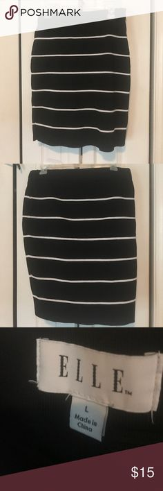 Black pencil skirt with white stripe Okay so this skirt says it's a large but it definitely runs big. I would say an XL is more accurate! It's actually very stretchy and comfortable. There's no zippers or anything! This hits just above the knees. The second pic is the back, btw! I just wanted to show it looks the same all the way around. Elle Skirts Pencil