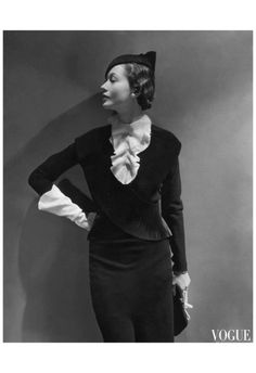 Toto Koopman wearing black wool dress with pleated jabot and black felt hat by Mainbocher, and Antelope handbag by Germaine Guerin, 1934 | mondfaenger Photo by George Hoyningen-Huene