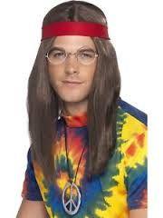 Miesten hippisetti. Sisältää peruukin, lasit, rauhanmerkin ja päänauhan.