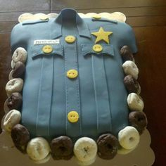 Police academy graduation cake --- LOVE the donuts around the cake haha