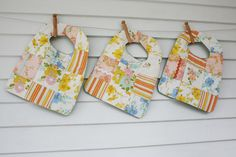 love these bibs made from vintage sheets...Craftyblossom: sewing with vintage sheets.