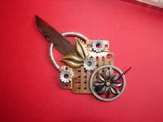 Hey, I found this really awesome Etsy listing at http://www.etsy.com/listing/83750621/steampunk-pin-found-objects