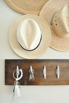 Easiest DIY Key Hook * Stain a piece of board * Add hooks (I used cleats) * Attach to the wall.