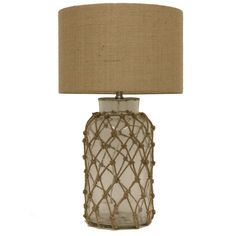 This seeded glass lamp is all tied up, with a rope netting that will add a nautical chic touch to your living space. Paired with a streamlined natural burlap drum shade, it seamlessly combines modern elements with coastal inspired traditional features.