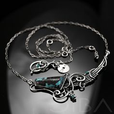 Eliane  An original, exclusive, silver necklace with natural turquoise. Entirely hand made, using the wire-wrapping technique. $227.95 Click to see details!