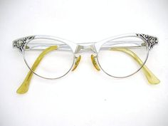 Very beautiful pair of silver tone cat eye glasses or sunglasses frame. They are in good used condition. Normal wear. Please note these will need to have the plastic earpieces replaced. Very nice frames. Strong five barrel hinges. They have no lens in. Ready to have your Rx or sunglasses lens put in. Please ask any questions. I have more eyeglasses listed.Check out my shop for more unique vintage eyewear. http://www.etsy.com/shop/Vintage50sEyewear Lens size - 44mm Bridge s...