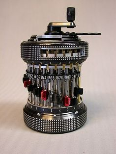 Curta Mechanical Calculator, a small, hand-cranked mechanical calculator introduced by Curt Herzstark in 1948. It can be used to perform addition, subtraction, multiplication, division, and (with more difficulty) square roots and other operations.  considered the best portable calculators available until they were displaced by electronic calculators in the 1970s.