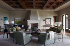 Santa Barbara living room in soft neutrals with coffered wood ceiling