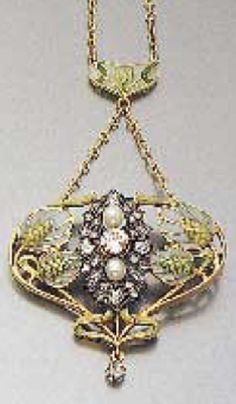 An Art Nouveau enamel, pearl and diamond pendant, mounted in gold and silver, circa 1900.