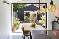 Architect Richard John Andrews has built The Light Shed, a fibreglass-clad multi-function shed in his east London garden that's his own architects' studio. Timber Sliding Doors, Sliding Door Systems, Backyard Office, Backyard Studio, Modern Backyard, Garden Office, Backyard Landscaping, Prefab Buildings, Small Buildings