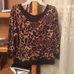 Leopard print top by Almost Famous Gorgeous light weight top with beautiful lace back. Looks stunning with a slight sex appeal. Almost Famous Tops Blouses